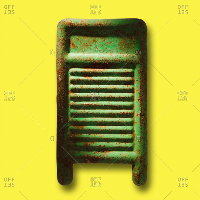 Toy washboard on yellow background