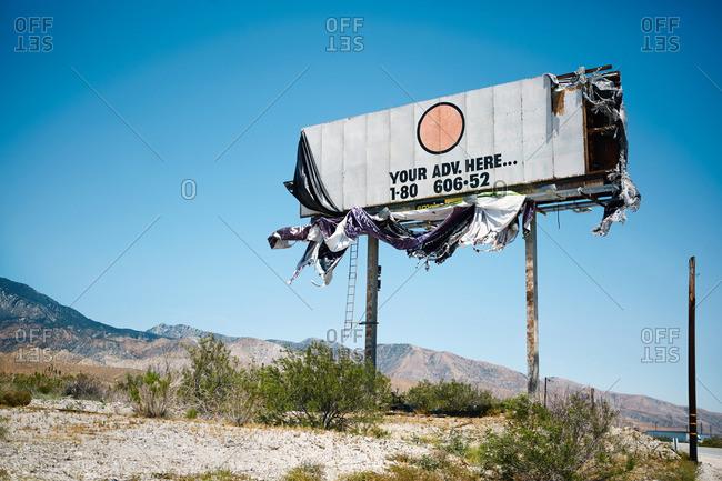 Decaying billboard in rural setting