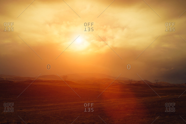 Glowing sunlight over rolling hills