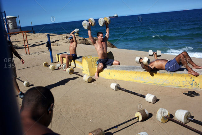 Rio de Janeiro, Brazil - July 6, 2010: Fitness enthusiasts work out at an outdoor gymnasium overlooking the ocean at Parque do Arpoador