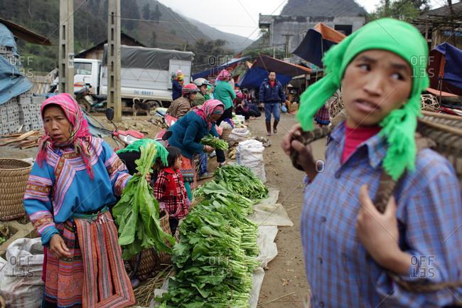 Lung Khau Nhin Market, Vietnam - March 15, 2012: Women selling vegetables at Lung Khau Nhin Market in Northern Vietnam