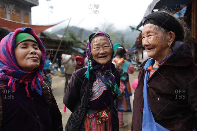 Lung Khau Nhin Market, Vietnam - March 15, 2012: Three smiling elderly women at the Lung Khau Nhin Market in Northern Vietnam