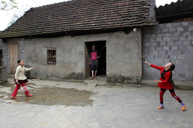 Northern Vietnam - March 15, 2012: Youngsters play badminton near Sapa