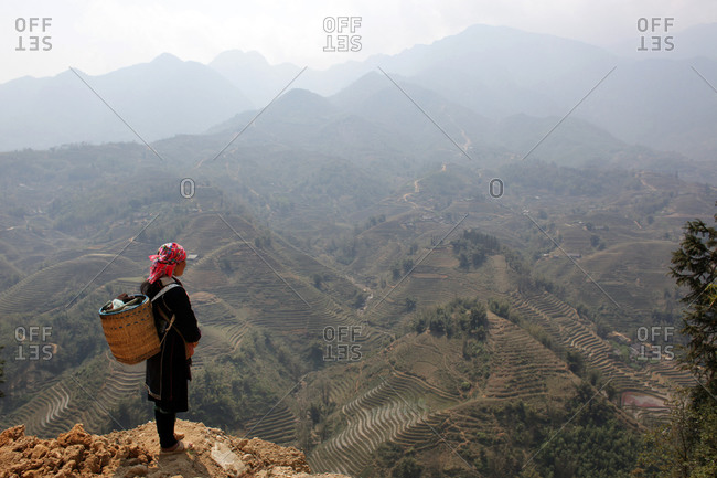 A Black Hmong guide overlooks the highlands near Sapa close to the Chinese border in Northern Vietnam