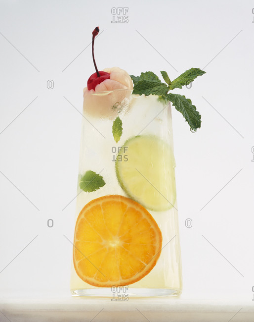 Lychee cooler with cherry, citrus, and mint