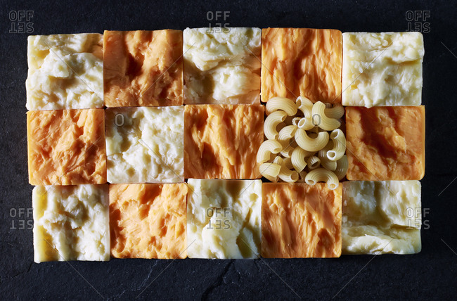 Macaroni and cheese ingredients in a grid shape