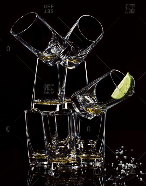 Pyramid of shot glasses with tequila