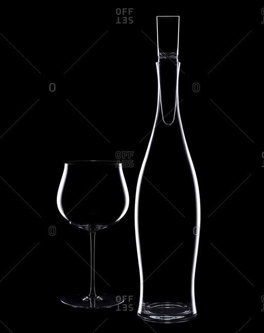 Silhouette of a wine decanter and glass