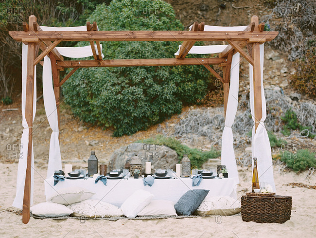 Table set for a dinner party on the beach