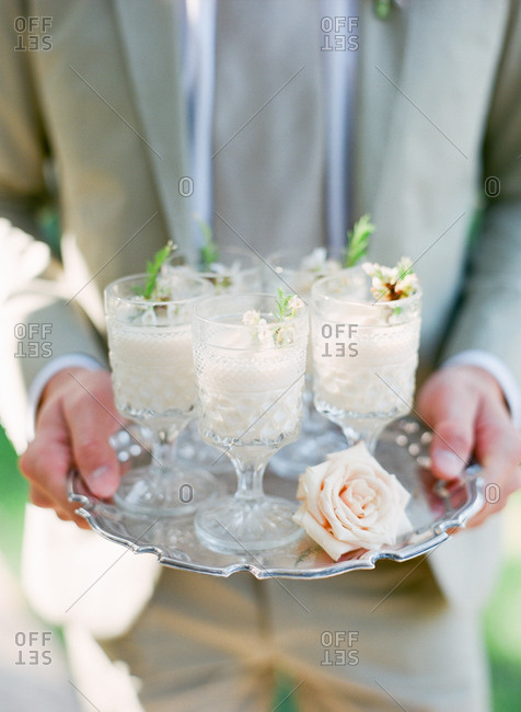 Man holding tray of cocktails