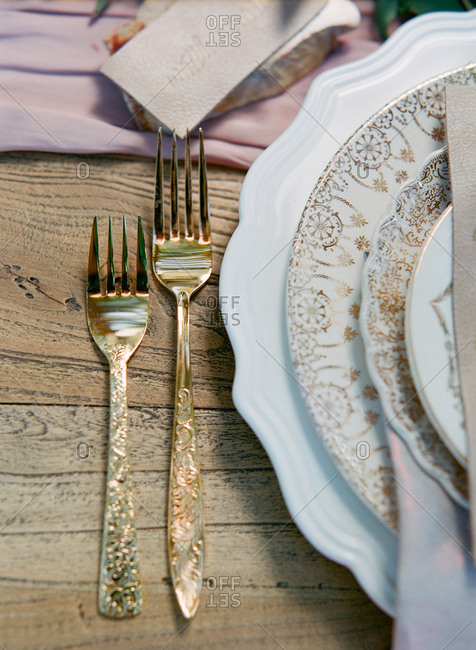 Gold forks in table setting at wedding reception