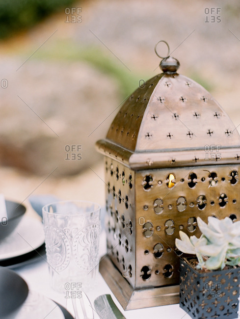 Close up of lantern lit with a candle