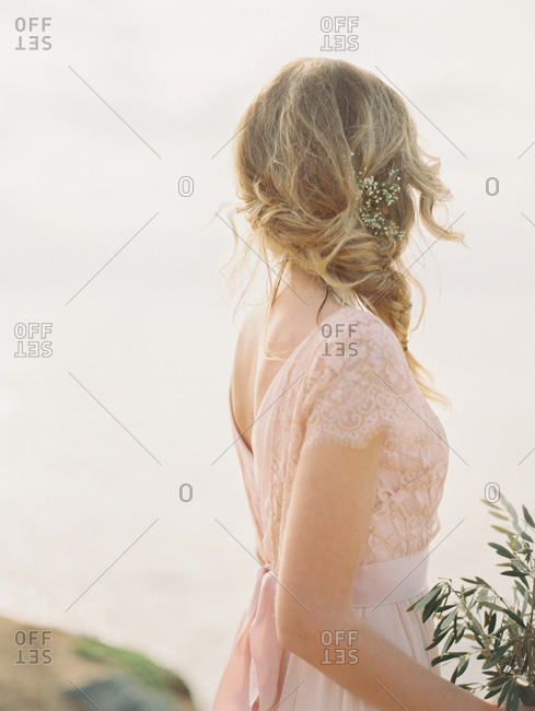Bridesmaid with her head turned away
