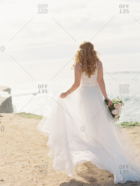 Bride on the beach on her wedding day