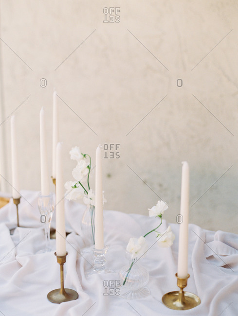 White flowers and candles on a table