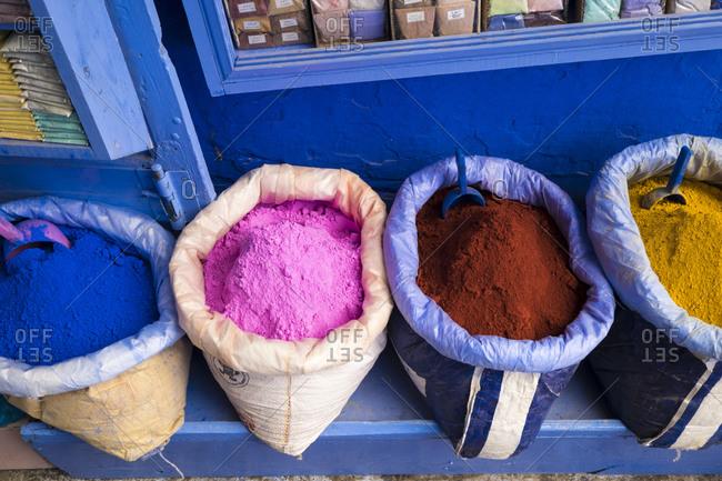 Chefchaouen or Chaouen, paint pigments in burlap sacks
