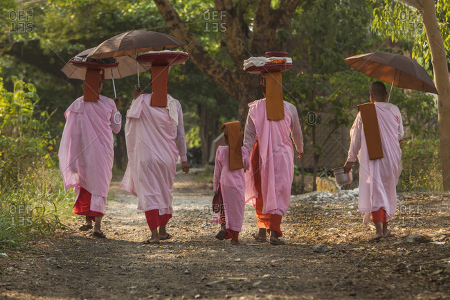 Buddhist nuns walking down road, Myanmar, Mandalay