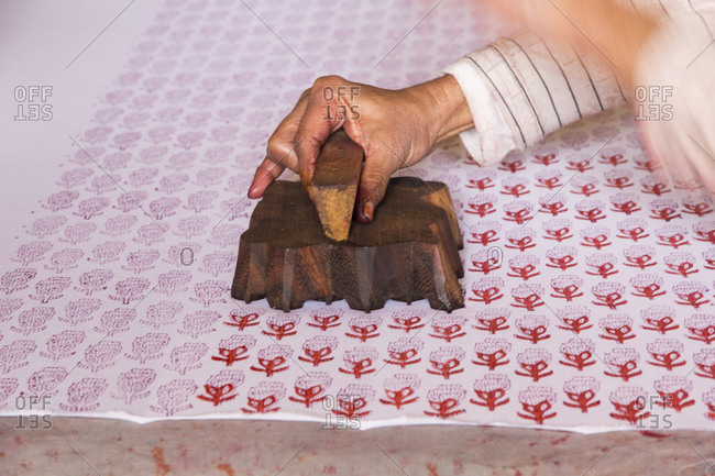 India, Rajasthan, Jaipur, stenciled print making on bolts of cotton cloth