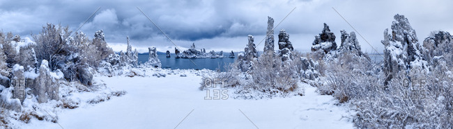 Mono Lake South Tufa area, Panoramic view of tufa formations at dawn after a fresh snowfall, California
