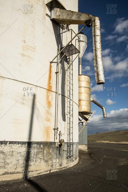 Dusty grain elevators for Lacrosse Grain Growers just west of Pioneer Stock Farm