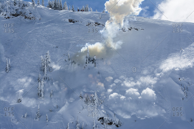 Explosive hand charge to trigger and control avalanche at Grand Targhee Ski Resort