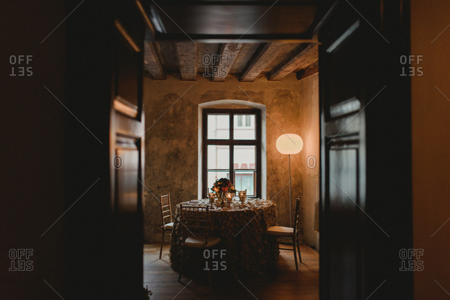 Table at a wedding reception through french doors