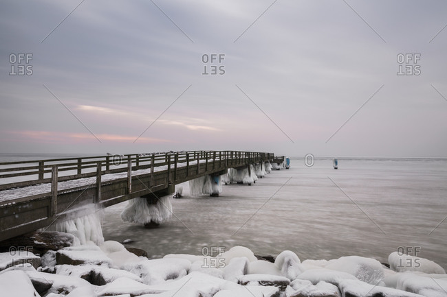 View to pier in winter