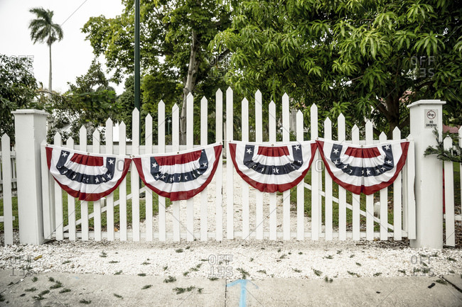 Gate with flags in Fort Myers, Florida