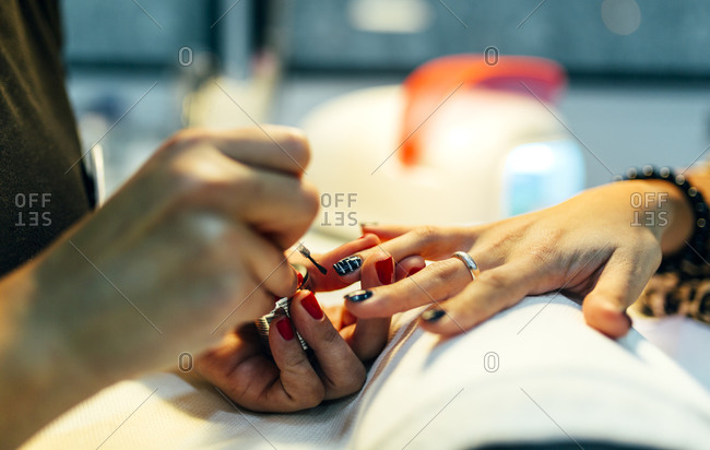 Close up of nail grooming in beauty salon