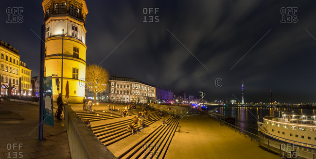 North Rhine-Westphalia, Dusseldorf, panoramic view of Rheinufer promenade at night with stairs, Rhine river