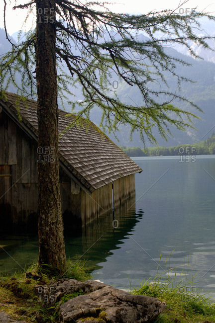 Wooden cabin at lakeshore of Lake Obersee, Berchtesgaden, Bavaria, Germany