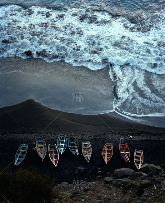 Overhead view of fishing boats on lava beach, Island of Fogo, Ilhas do Sotavento, Republic of Cape Verde, Africa
