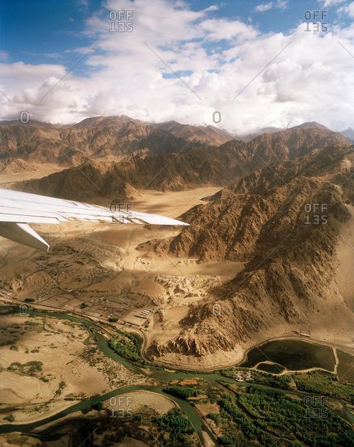 View from a jet, approaching the capital city Leh via the Indus valley ahead Karakorum Range, Ladakh, Jammu and Kashmir, India
