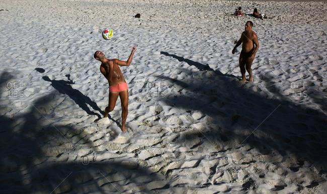 Rio de Janeiro, Brazil - July 8, 2010: Man playing with soccer ball on beach