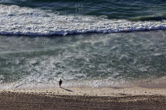 Man on Copacabana beach, Rio de Janeiro, Brazil