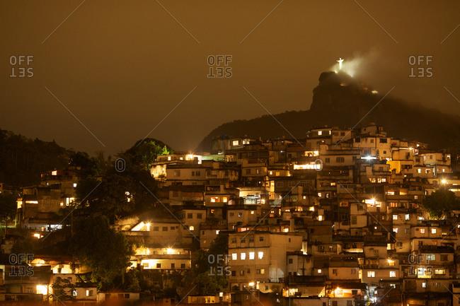 Christ the Redeemer over a favela