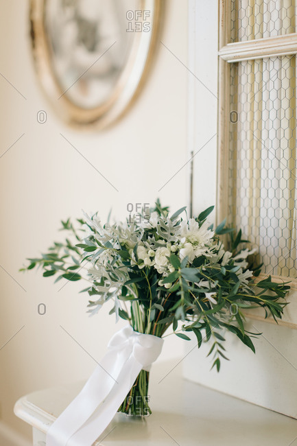 Wedding bouquet on top of a mantle