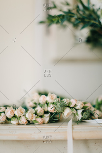 Close-up of tea roses on top of a mantle