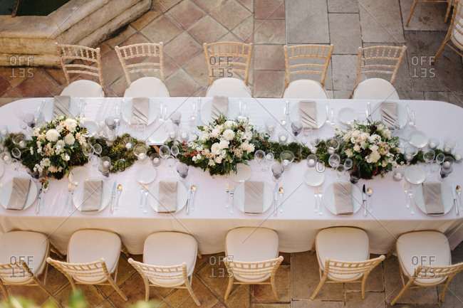 Birds eye view of a set table at a wedding reception