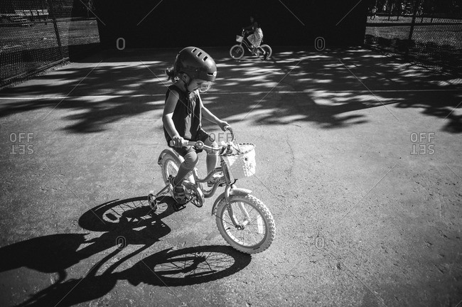 Little girls riding bicycles