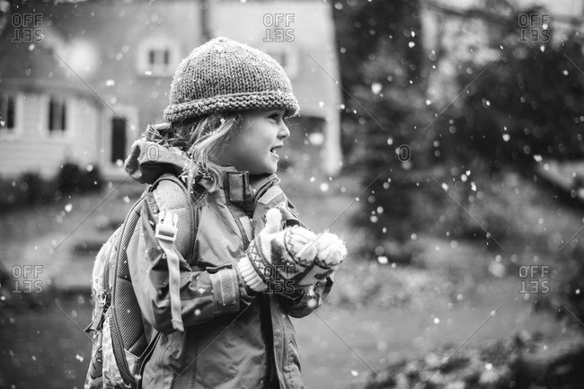 Girl standing outside in the snow