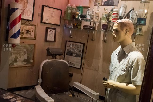 Brooklyn, New York, USA - January 16, 2016: Barber shop display in a museum, Williamsburg, Brooklyn, New York, USA