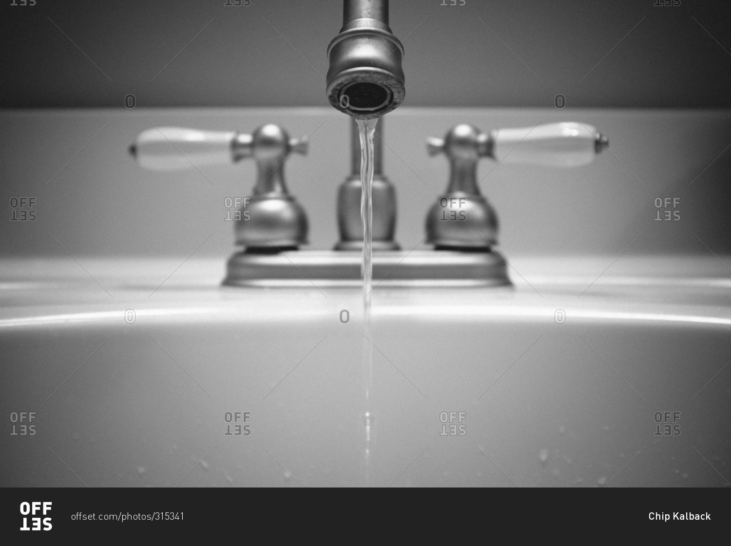 Water dripping from a bathroom sink faucet stock photo ...