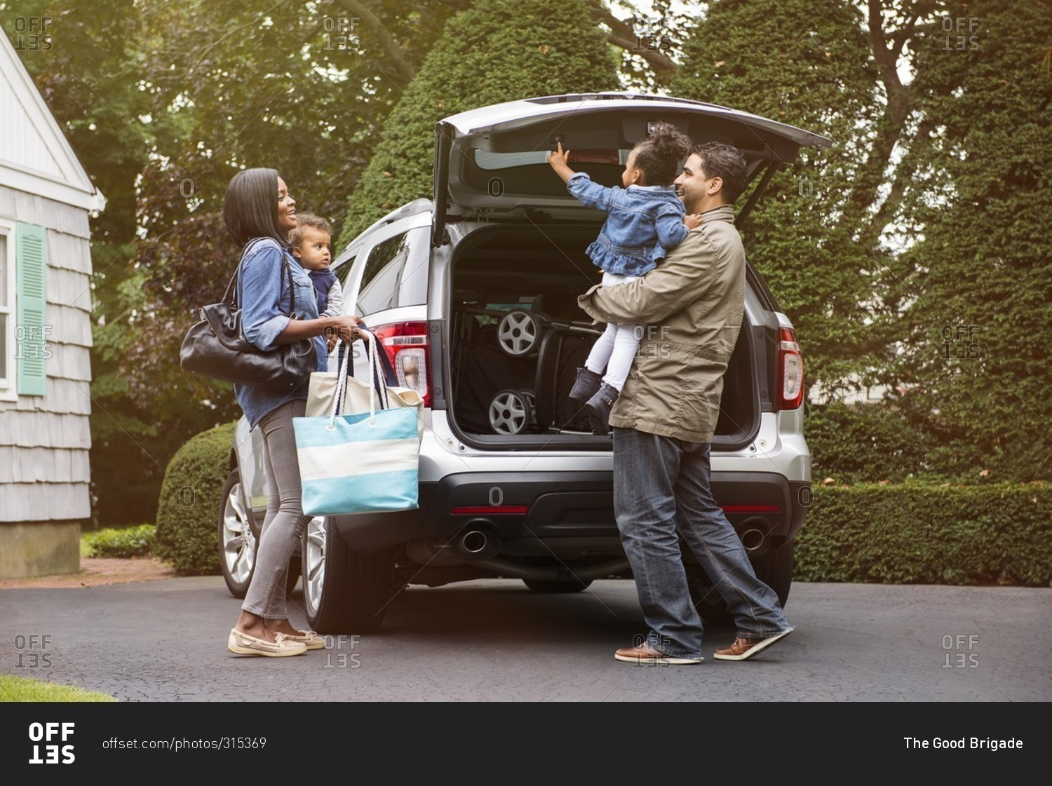 parents with children standing behind the family suv stock photo offset. Black Bedroom Furniture Sets. Home Design Ideas
