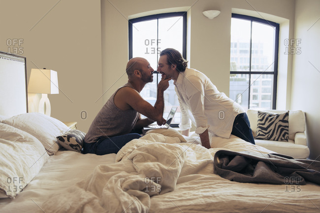 Affectionate couple getting ready in the morning in their bedroom