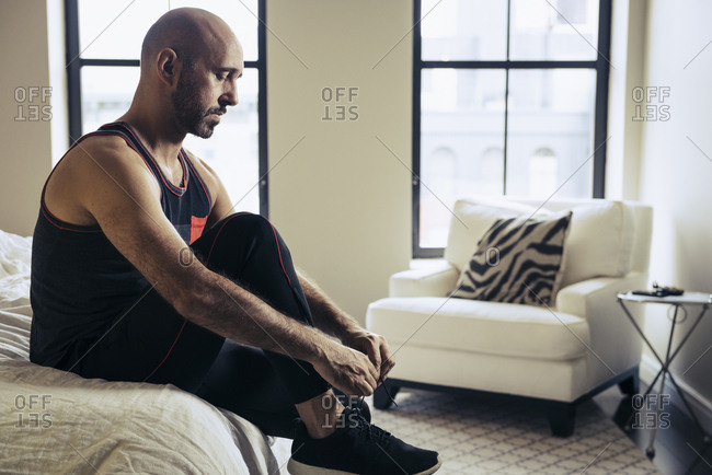 Man putting on fitness gear in morning for workout