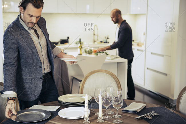 Couple preparing for dinner party