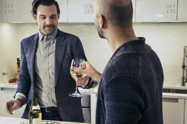 Man handing his partner a glass of wine