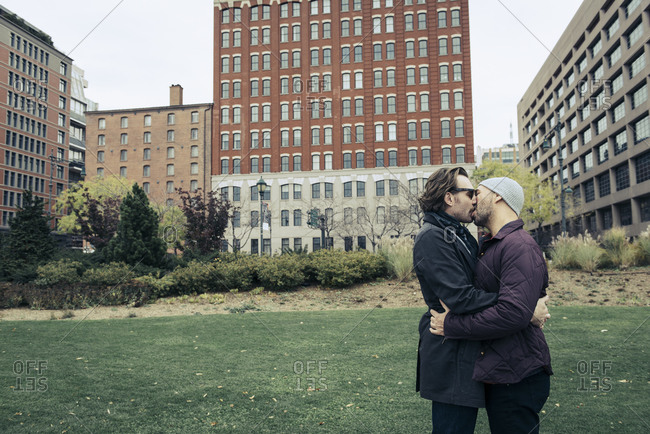 Couple share a kiss in Lower Manhattan park