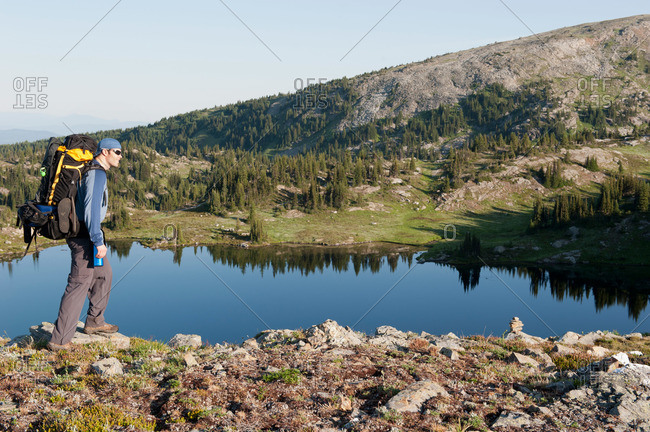 Hiker overlooking a mountain lake